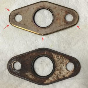 "o2sensor gaskets (new on top) - red arrows show tiny ""crimps"" in metal."